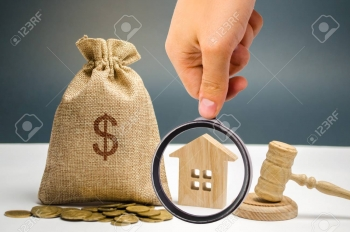 116139405-bag-of-money-house-and-gavel-confiscation-of-property-due-to-non-payment-of-taxes-property-alienatio